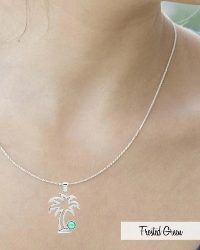 Add to cart this adorable Palm tree pendant