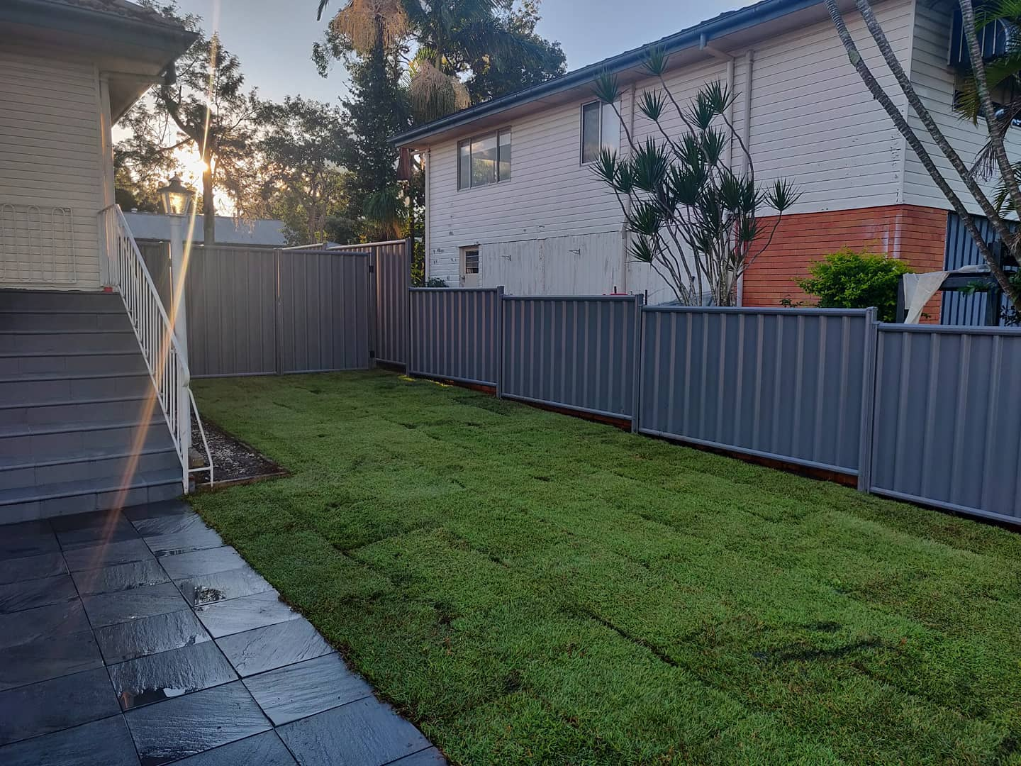 Colour bond fencing with double swinging gates