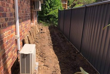 Massive yard raise into an oasis -Retaining and Fencing