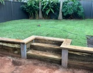 Retaining wall with steps and a full returf
